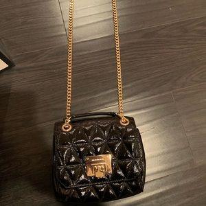 Michael Kors long crossbody multi use shiny bag